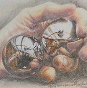 Hand holds reflective balls